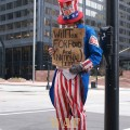 Uncle Sam at Chicago's Sears (Willis) Tower with a sign asking for National Debt money