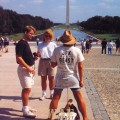 """a """"JFK is the Beast"""" protestor at the Washington Mall (with the pond and Washington Monument)"""