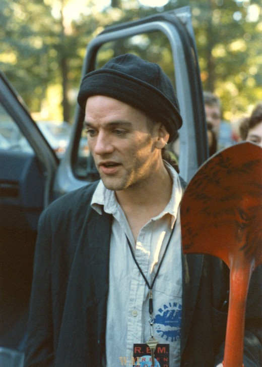 Michael Stipe (of REM) holding a shovel after planting a tree in Urbana, IL