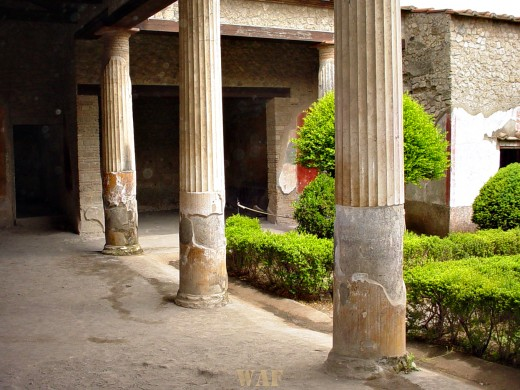 Columns and buildings in Pompeii, Italy that survived the Mt. Vesuvius 79 A.D. eruption