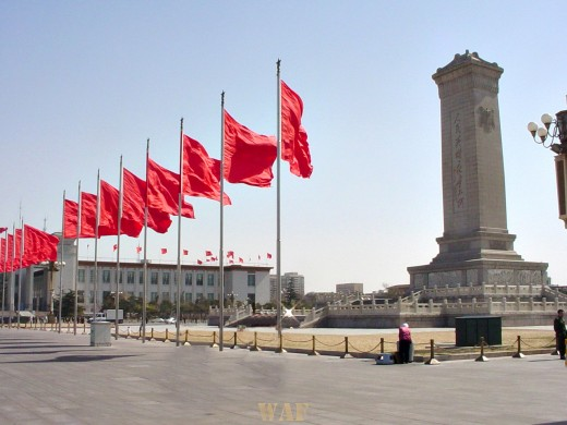a row of red flags along Tiananmen Square (Beijing, China)